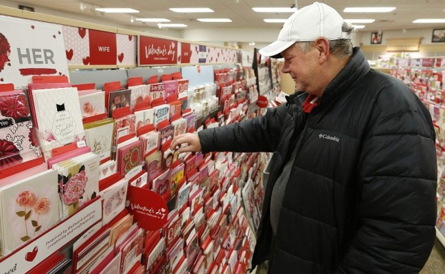 Elmhurst Husband looking at Valentine's Day cards